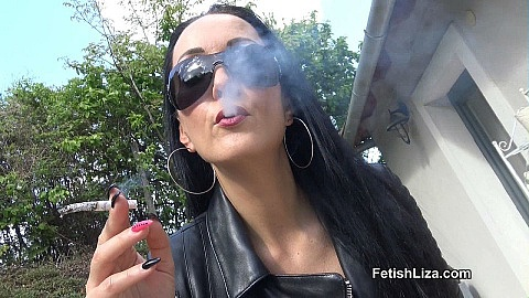 Smoking in leather chap boots