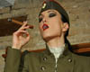 Ready for the smoke and strapon  military bitch smokes a fat cigar and presents her strapon. Military slut smokes a fat cigar and presents her strap-on.