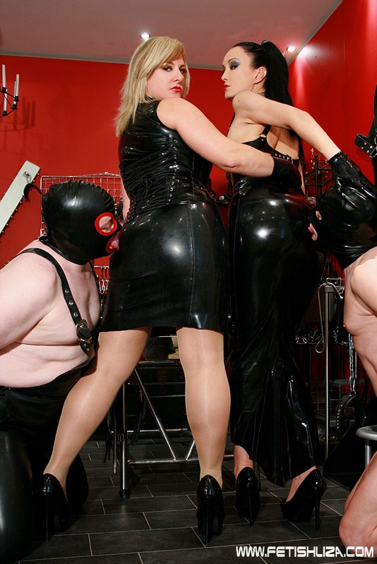 Mistress with strapon fucking and double fisting her sub 7